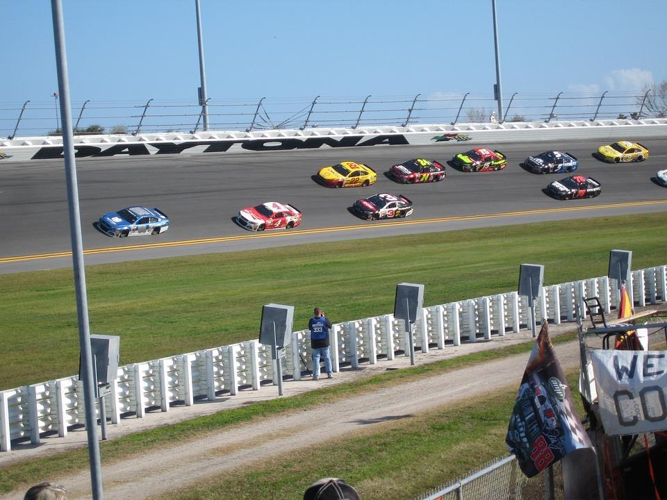 stock cars racing on Daytona track